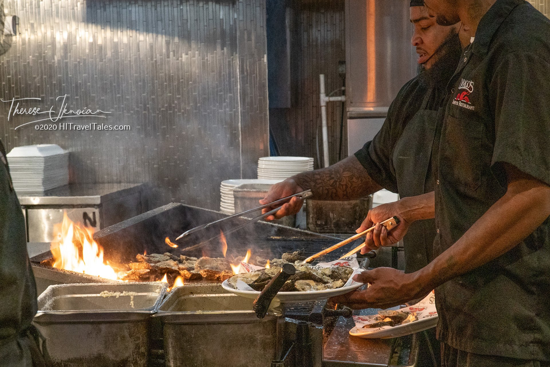 Charbroiling oysters at Drago's in New Orleans by Therese Iknoian
