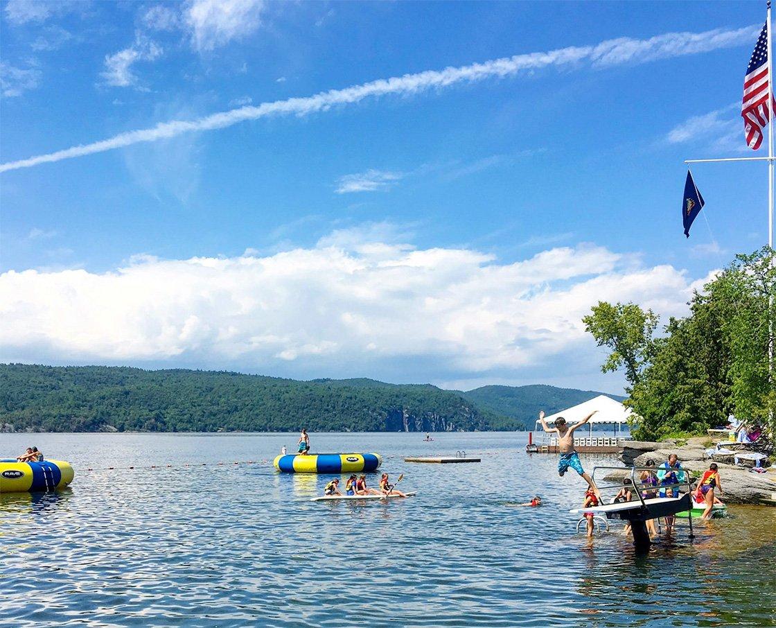 Kids playing in Lake Champlain at Basin Harbor Image by Lara Dunning